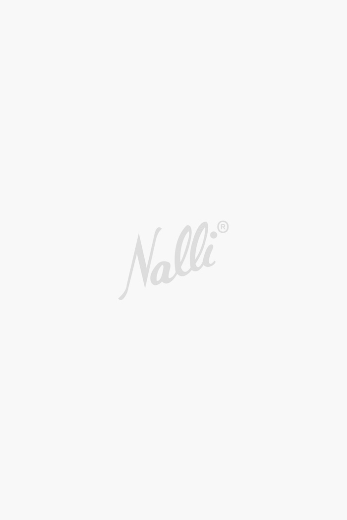 Beige and Green Pochampally Silk Saree